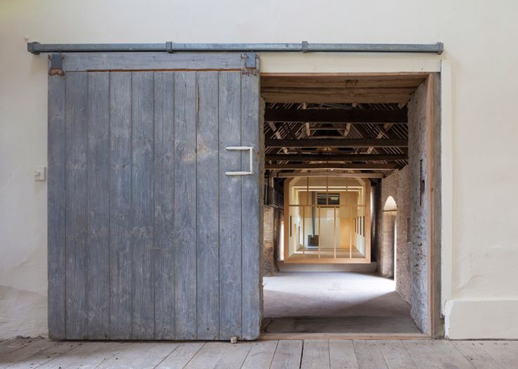 Private art gallery by Stonewood Design cantilevers into a 17th century Cotswolds barn.