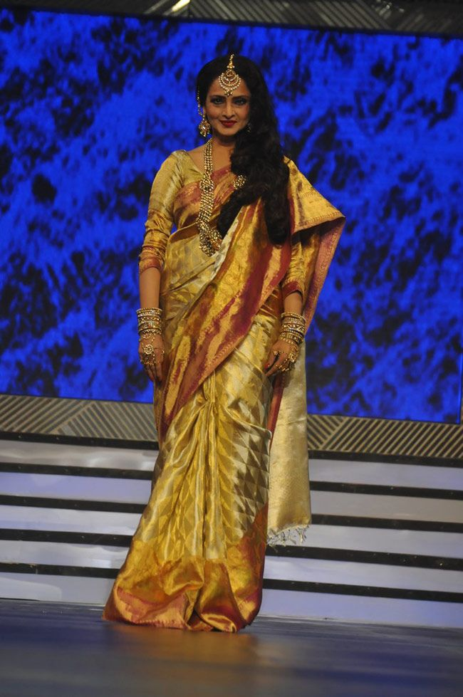 Rekha glitters all the way in her golden saree at an event to honour Yash Chopra Bollywood