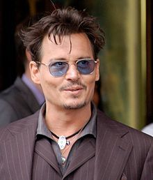 Depp at a ceremony for Jerry Bruckheimer to receive a star on the Hollywood Walk of Fame in June 2013