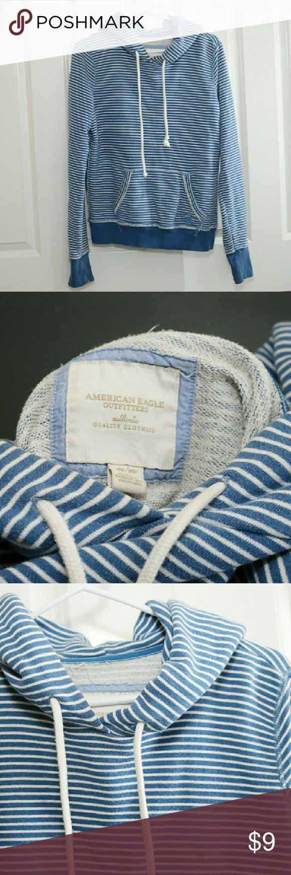 American Eagle Sweatshirt Blue Stripe Size Medium American Eagle Sweatshirt.  Blue stripes.  Size Medium.  Sweatshirt is overall in good condition.  There is a tiny hole in front pocket and some wear on the sleeves, one more than the other.  Both shown In pictures.  Price reflects wear. American Eagle Outfitters Tops Sweatshirts & Hoodies