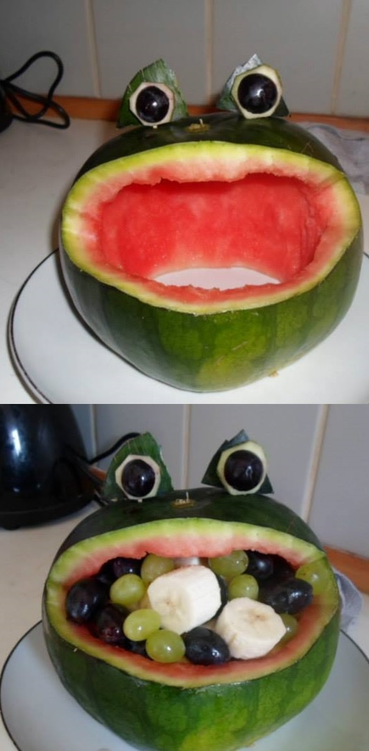 Frog carved out of watermelon and stuffed with fruit.
