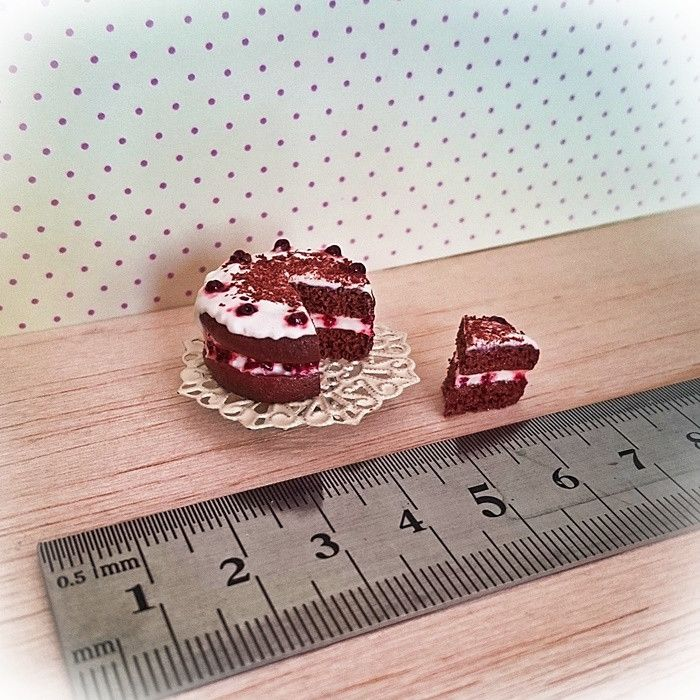 Black forest cake with metal cake stand.