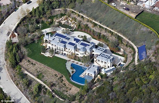 Tom Brady and Gisele Bundchen's Brentwood mansion with a moat to separate them from the rest of the world