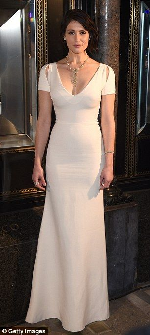 Front and back: The star's dress deftly proved that less is more - whether visible from be...