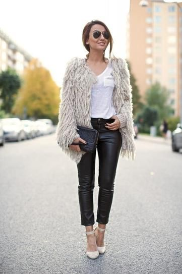 30 reasons you need a pair of leather pants - black leather pants, white t-shirt, and shaggy off-white winter coat + nude heels