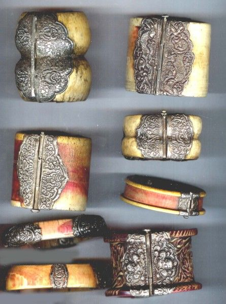 India | Ivory cuffs and bangles.  Some with henna, all clad with old style silver work.  | Most of the silver work was done between 1920's to 1950's and only added some time after it had been worn by its original owner and likely to have been done to make it easier to wear by its new non Indian owners. |  © Linda Pastorino