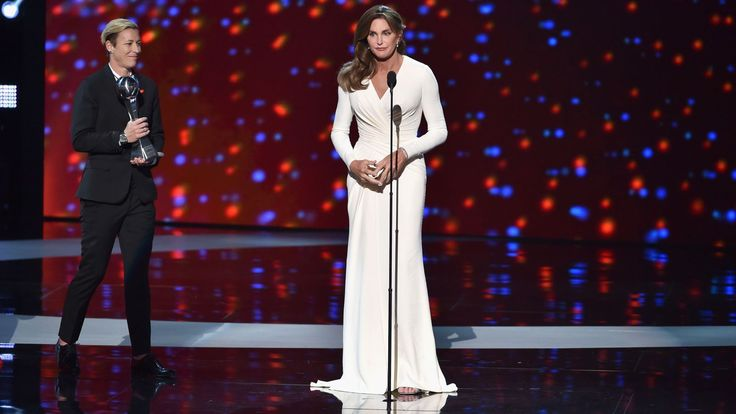 Clothes are more than just the cloth they're made of. We often use them as symbols to reflect or hide who we are, including our gender identity. The point may be obvious, but it's worth reiterating when considering the dress Caitlyn Jenner wore to accept the Arthur Ashe Courage Award at the ESPY Awards on July 15. It was Jenner's first big awards show since her transition, and for it she chose a long, columnar white gown by Atelier Versace. Its wrapped front brought the dress in at the…