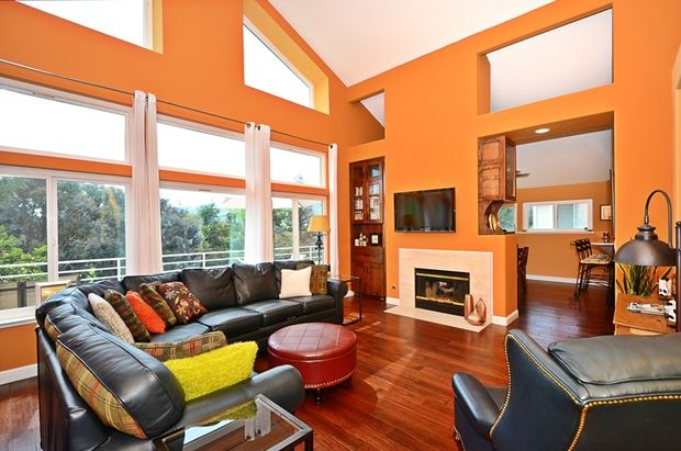 Orange Living Room Built-in bookshelf Hardwood floors High ceiling stone fireplace Traditional