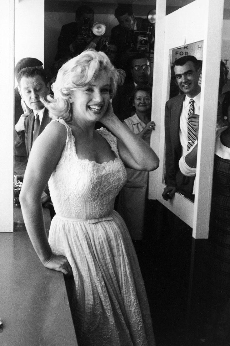 1957 Marilyn Monroe smiling, luminous in a lacy dress