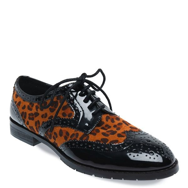 Animal print Oxford shoe with patent details and decorative perforations.