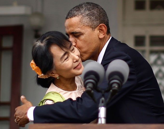 US President Barack Obama kisses Aung San Suu Kyi following joint remarks at her residence in Yangon.  Obama became the first serving US president to visit Myanmar, during a whirlwind six-hour trip.
