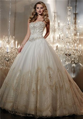 White and Gold Wedding. Sweetheart Corset Ballgown Dress. Strapless ball gown with basque waist, heavily beaded bodice, and full tulle skirt with beaded lace hem. Lace-up back and semi-cathedral train.
