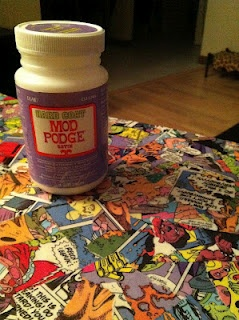 Decoupaging furniture. I love this idea of using cheap comics to decorate a table.