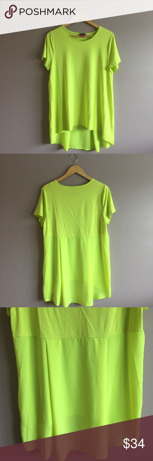 """Women's Vince Camuto Neon Green Short Sleeve Top Women's Vince Camuto Neon Green Short Sleeve Top  •Size: Large •Armpit to armpit: 19"""" •Shoulder to shoulder: 16"""" •Length: 25.6"""" •Features a sheer lower back •From a smoke-free and pet-free home •In very good condition  Fast shipping (same day) during business days if ordered before 4PM Eastern Time  No trades  Bundle & save!! (5% off 3 or more items) or add to a bundle & I will make you an offer Vince Camuto Tops Blouses"""