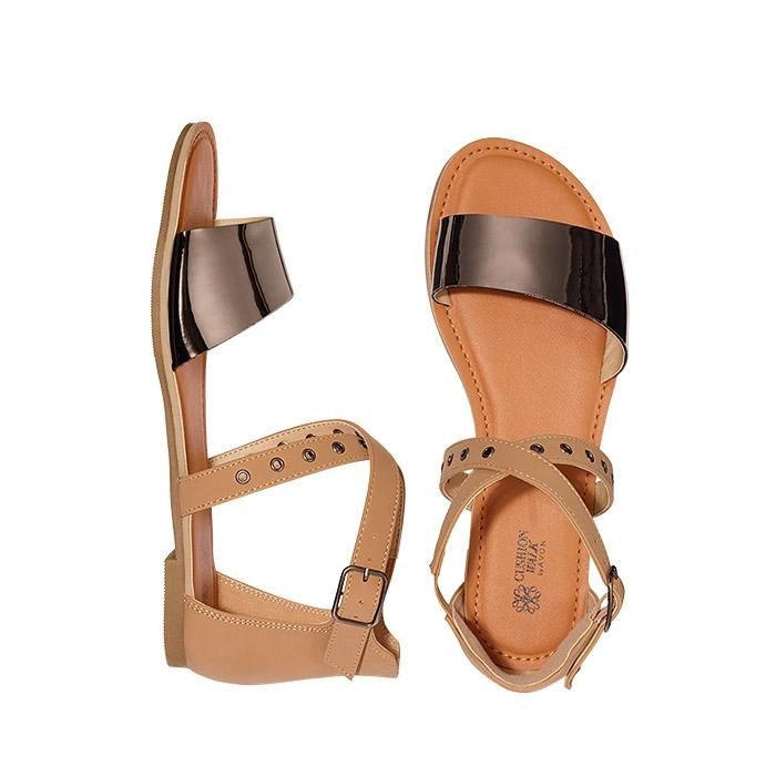 """Crisscross Comfort Flat. These nature-inspired classics will help transition your wardrobe into spring effortlessly. FEATURES• Tan leather-like sandal features mirrored pewter and grommet details• Functional side buckle closures on ankle strap• Tan strap in back, crisscross strap with mini grommets and metallic toe strap• Cushion Walk padded footbed• Shoe is flat except for 3/8"""" rise at heel• Whole sizes: 6M - 10M• Runs true-to-size• Bottom of the soles are skid-resistant MA..."""