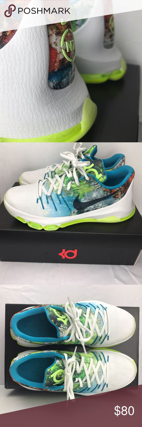 KD 8 Big Kids Basketball Shoes (size 7Y) Kevin Durant basketball shoes. Great condition. Worn playing basketball once. So they are not even broken-in. Selling as is. Black socks were worn when playing in these shoes so you will see the cotton balls from those socks in them. However they are in great condition and I depict in the picture their condition best as possible. The bottoms of the shoes do glow in the dark. See Nike shoe size chart to see shoe size requirements. Nike Shoes Sneakers