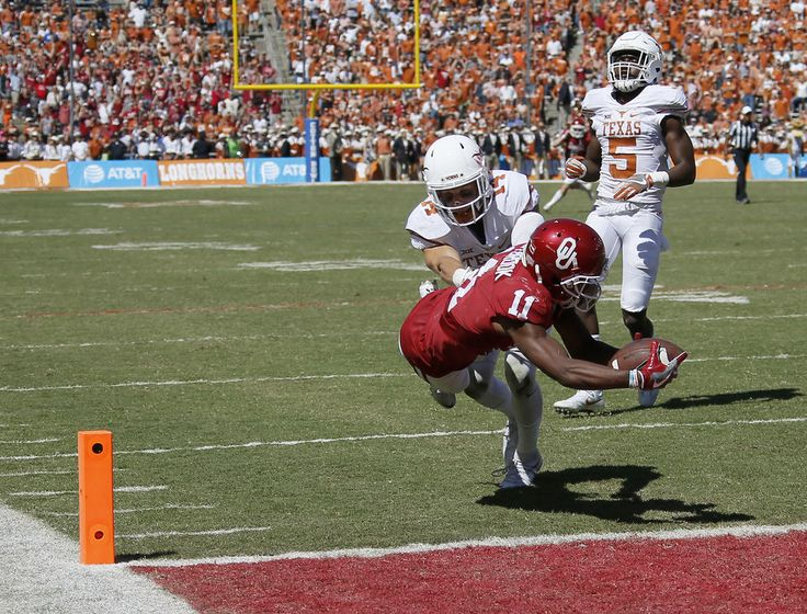 Oklahoma's Dede Westbrook (11) leaps for the end zone to score in front of Texas'  Dylan Haines (14) and Holton Hill (5) during the Red River Showdown college football game between the University of Oklahoma Sooners (OU) and the Texas Longhorns (UT) at Cotton Bowl Stadium in Dallas, Saturday, Oct. 8, 2016. Oklahoma won 45-40. Photo by Bryan Terry, The Oklahoman