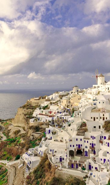 Rock-hewn suites, private Jacuzzis and a candlelit restaurant make up this romantic retreat in #Oia.