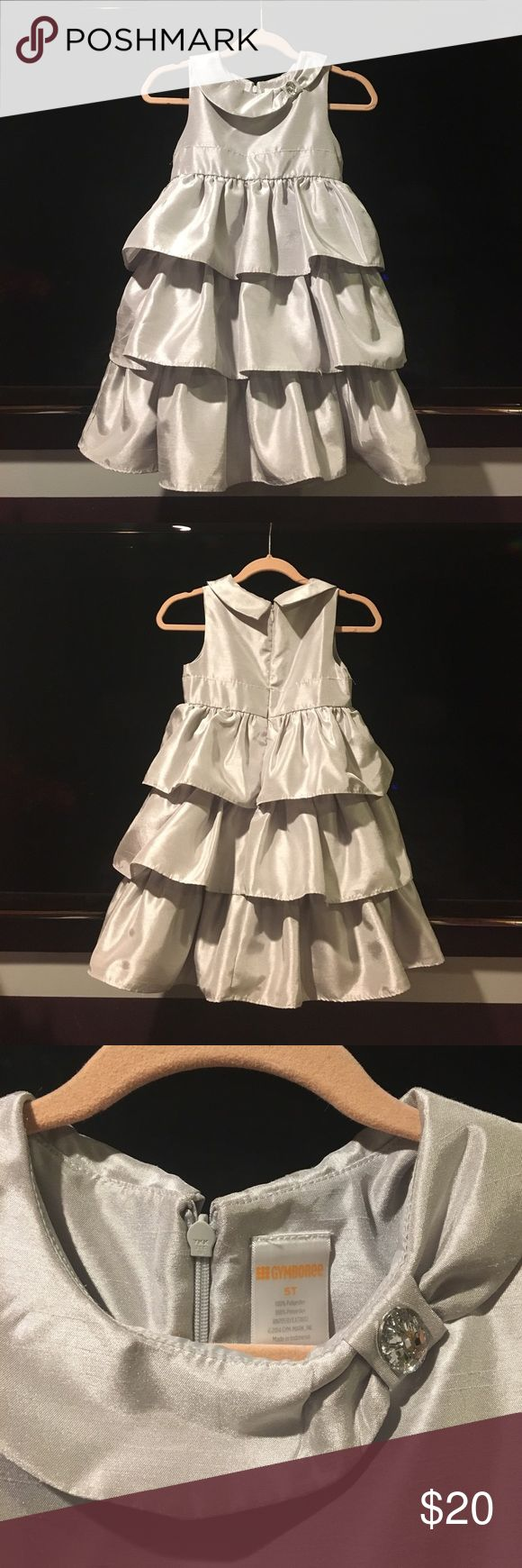 Beautiful Christmas dress in silver ! Beautiful little girls dress . Worn once for Christmas party. Size 5T Gymboree. Silver color. Very comfy! Gymboree Dresses Formal