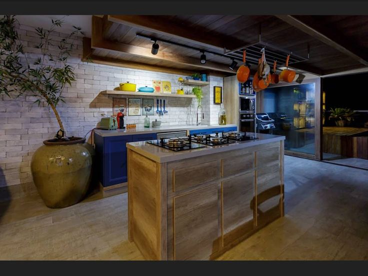 Ilha para cooktop: Cozinhas tropicais por Montenegro Arquitetura