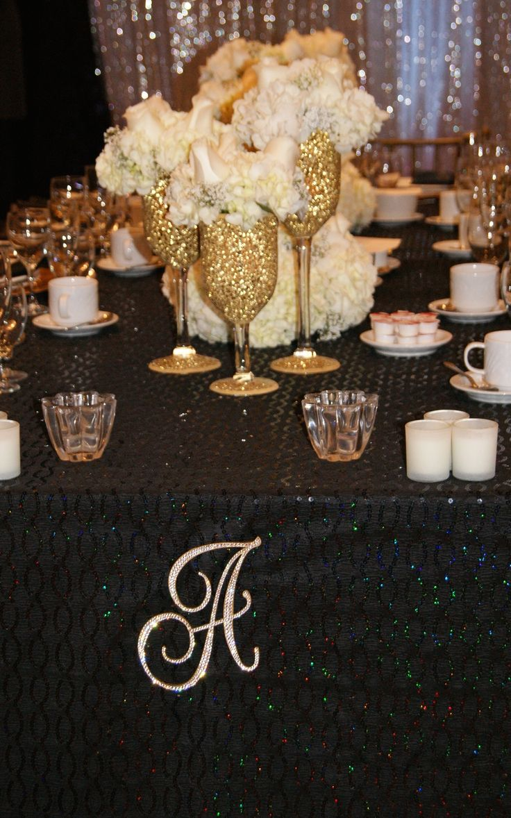 Love Letters adorning one of two wedding party tables facing the dance floor. The monograms beautifully complimented the monogrammed floor decal.
