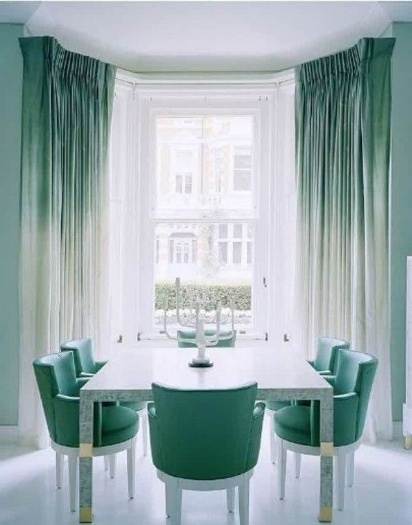 The late British designer David Collins was known for his particular faculty with the color blue. This seawater-hued London dining room, complete with softly ombréd draperies, is evidence of his gift.