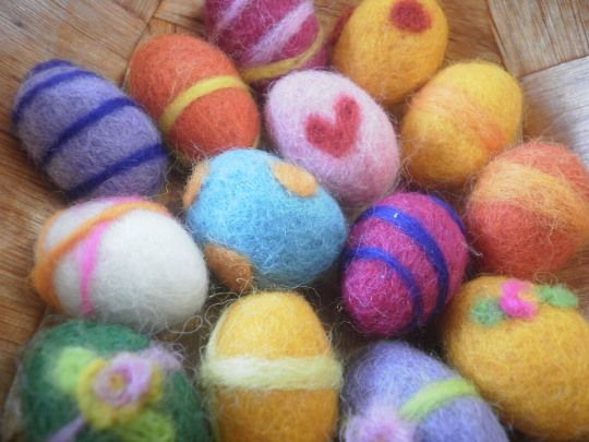 wet felted eggs with needle felted embellishments