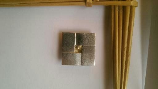 Bridget's Cross.  Contemporary interpretation showing the weave with a gold woven insert.