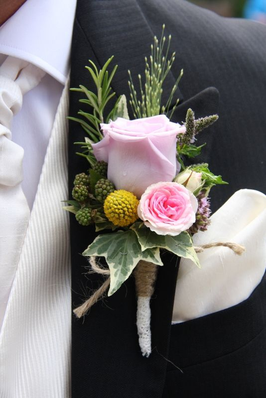 The Groom's Boutonniere of a Faith Rose with Mimi Eden, Mint, Rosemary, Craspedia and Oregano with fresh Rosemary, the stem was finished with lace and jute