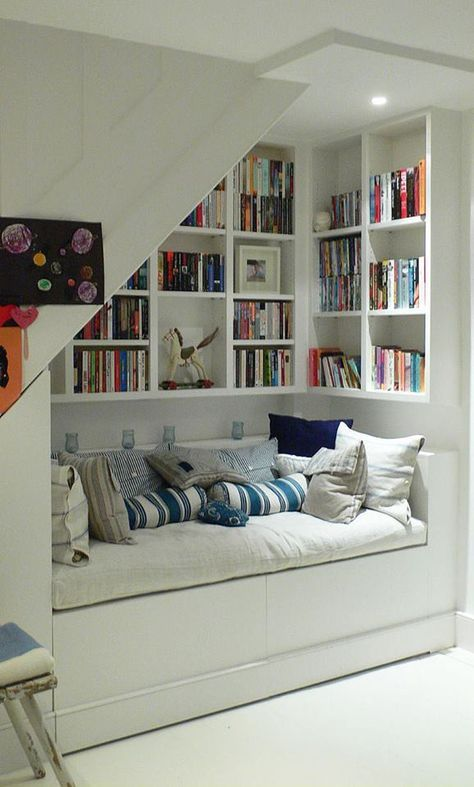 I could do with a little less white, but I want my eventual home to have plenty of random reading nooks like this.
