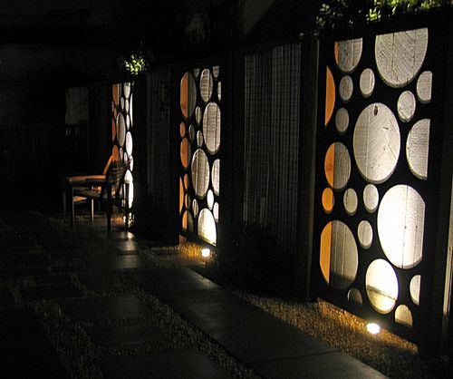 """Reap the rewards of Dumpster diving. These """"holey"""" steel plates are offcasts from manufacturing. Mounted, framed and backlit, they make a dramatic and playful statement night or day. Backlit panels by Shades Of Green Landscape Architectures"""