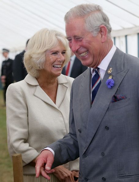 Prince Charles, Prince of Wales and Camilla, Duchess of Cornwall laugh during a visit to the 132nd Sandringham Flower Show