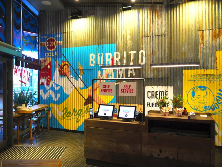 Burrito Mama interior, all hand painted vintage effect adverts on reclaimed corrugated iron walls.