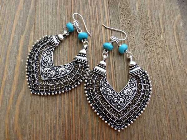 Boho hearts. Turquoise stone and sterling silver chandelier metal earrings.