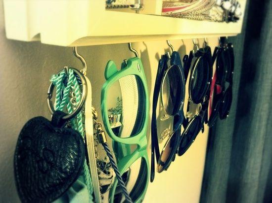 Put hooks under bathroom mirror to store jewelry, etc..