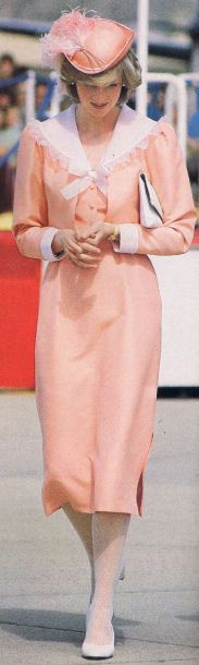 Diana, Princess of Wales in a cantaloupe colored dress and matching hat in 1981. This is the same outfit she wore when leaving Buckingham Palace after the wedding lunch to start their honeymoon.