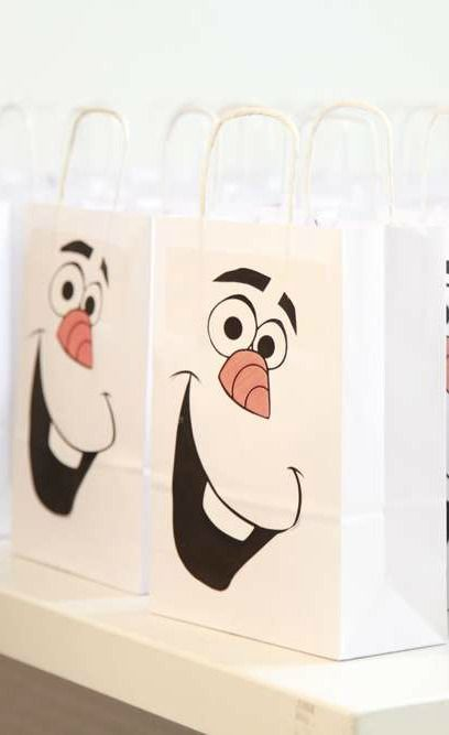 Olaf favor bags at a Frozen birthday party!  See more party planning ideas at CatchMyParty.com!