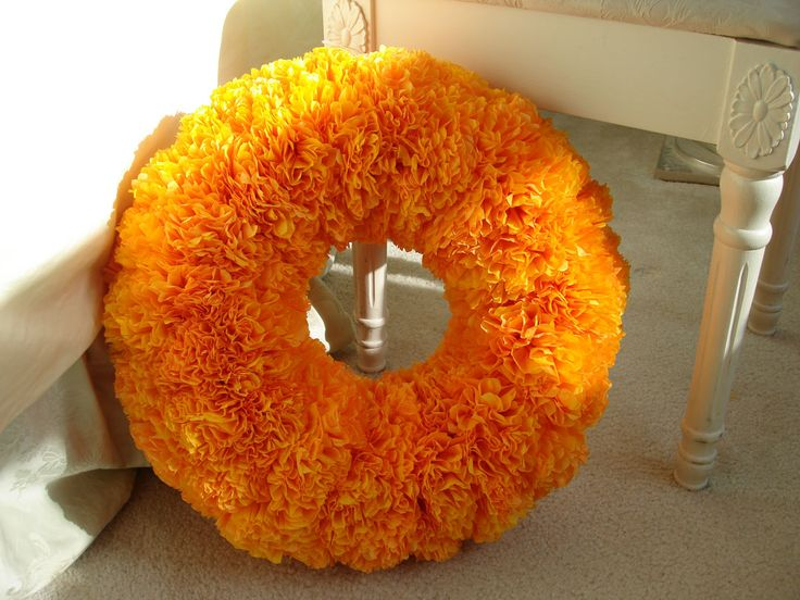 <p>Hey all!  Remember a little while ago I took a little vote on the wreath I should make for my brunch door?  Well, with your help I chose the tissue paper wreath, and here's the result of the escapade!</p> <p> {author's personal collection}</p> <p>All of my inspiration came from Amanda's awesome tissue paper pomanders.  On her advice, I purchased tangerine …</p>