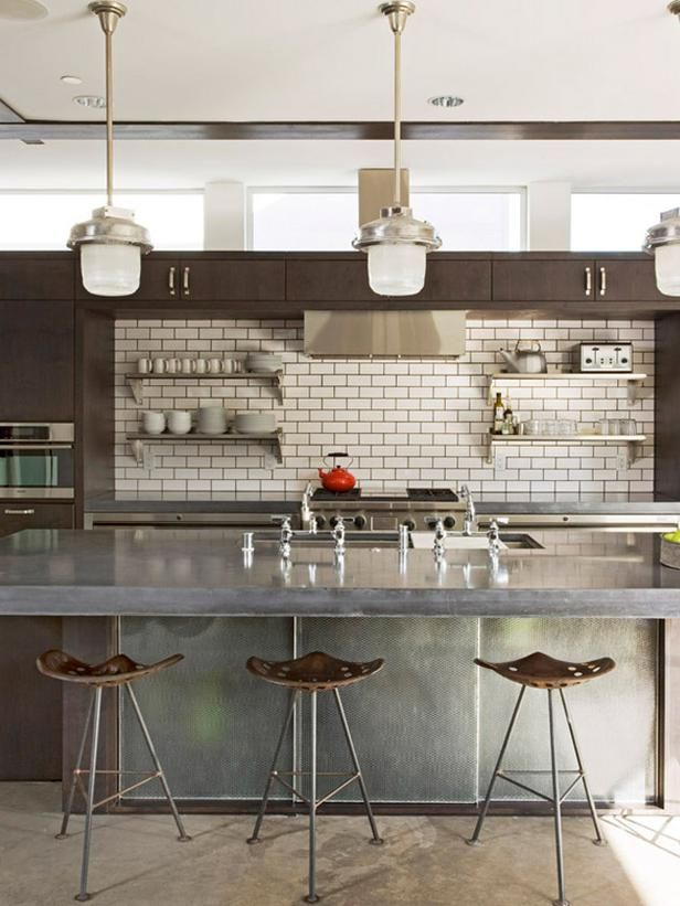 Beautifully-Organized Open Kitchen Shelving: Subway tiles and attractive stainless steel shelving give this kitchen a sleek city style. From DIYnetwork.com