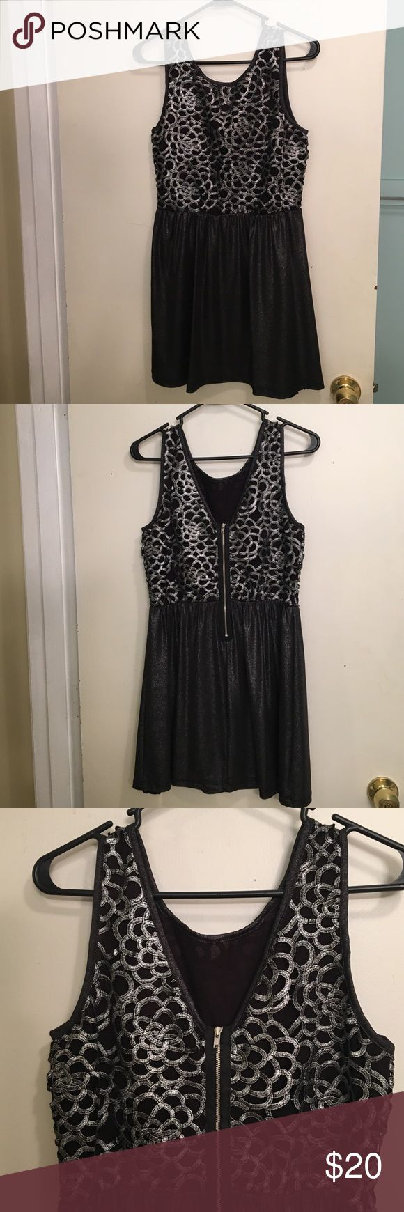 Black and silver dress NWOT. Never worn! I bought this dress but it ended up being too short for me as I am 5'9 with a long torso. Super cute on and comfortable though! Lovemarks Dresses Mini