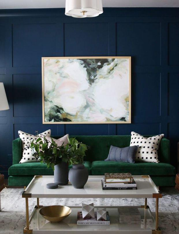 This navy-paneled room works for so many reasons, but the velvet forest green tuxedo sofa is certainly the star of the show. | Designer: Studio McGee