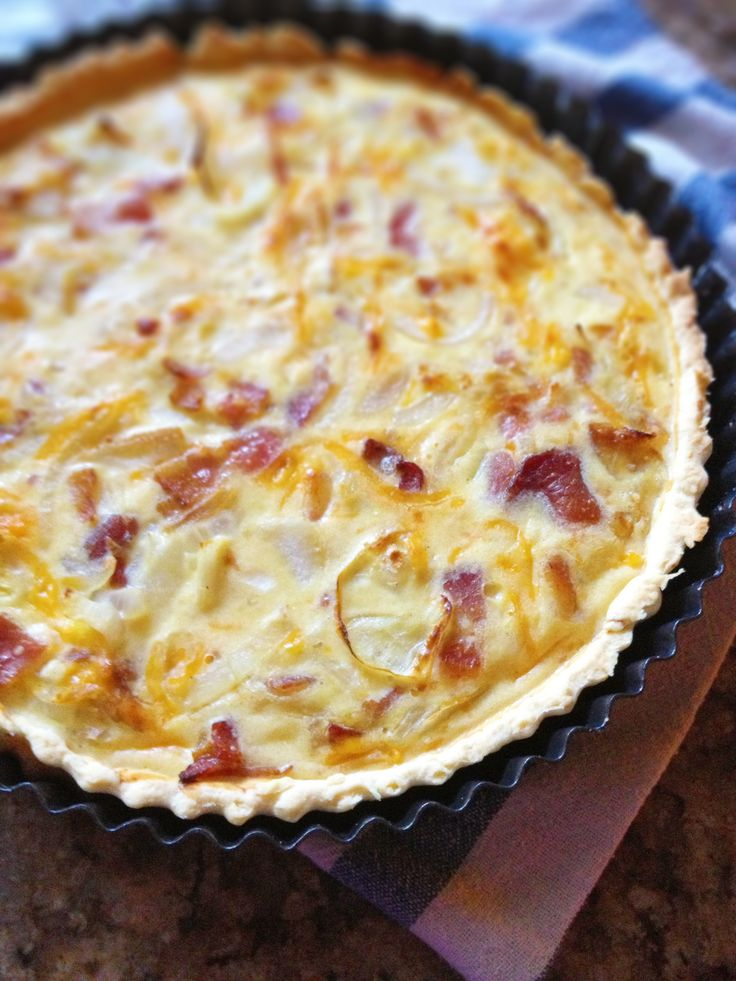 This tart is a dreamy combination of savory cheeses, milk, eggs, onions, bacon and cheddar. The perfect breakfast/brunch dish.