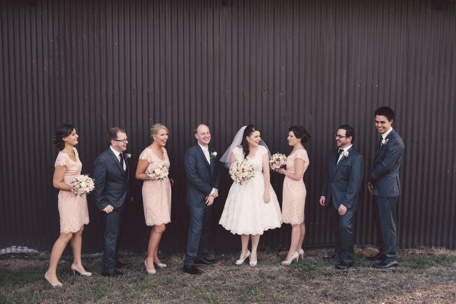 Vintage Bride ~ Real wedding of Kelly & Toms ~ Photography by Jess Marks Photography ~ Dress by Retro Bride ~ Florist Hyde Roses ~ Cake by Farmgate Cheese ~ Venue Albert River Wines, Mt Tamborine ~ More info at [vintagebridemag.com.au] ~ #vintagebride #vintagewedding #vintagebridemagazine
