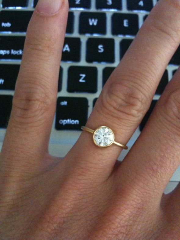 love this. simple, thin band, yellow gold. perhaps something other than a diamond?