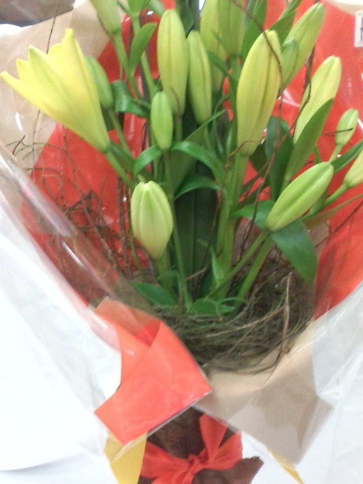 $65.00Au* - Welcoming and Bright Lily's in Glass Vase.  *Delivery is Not Included in Prices shown.