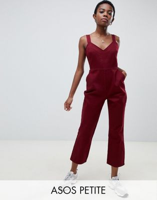 19b13d9bcd Shop ASOS DESIGN Petite denim jumpsuit with kickflare in berry at ASOS.  Discover fashion online.