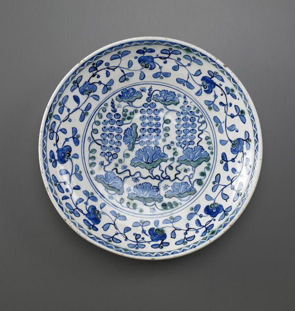 Dish with Grape Design  late 16th century      Ottoman period     Stone-paste painted under colorless glaze  H: 5.9 W: 32.5 cm   Iznik, Turkey   Freer  F1970.25