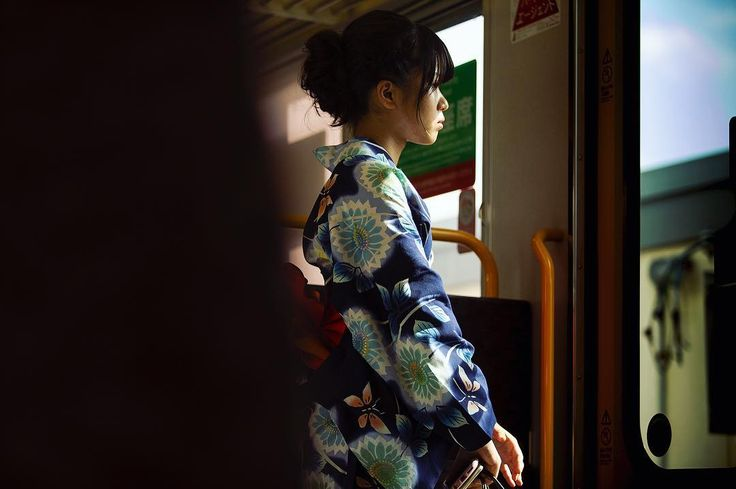 84/365. A girl wearing a kimono on a train in Kyoto.
