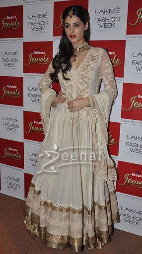 Nargis Fakhri glams the ramp for Ritu Kumar at Lakme fashion week.She wore a floor length fawn Anarkali Frock.