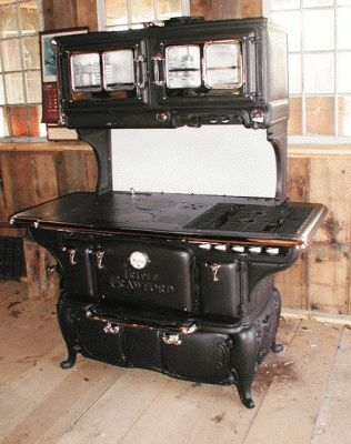 old victorian wood stoves | with a nickel knob below the ovens. Cooktop has 6 lids for wood ...